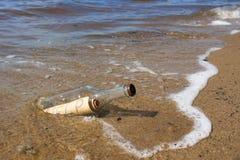 Bottle into the sea. Royalty Free Stock Photos