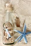 Bottle and sea stars Stock Images