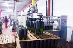 Bottle sealing and labling conveyer line in plant Royalty Free Stock Image