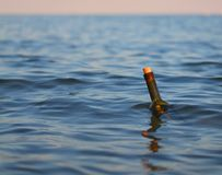 Bottle with a secret message in the middle of the ocean Stock Photos