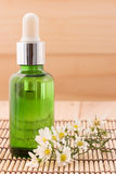 Bottle serum for beauty Spa and therapy treatment wiht wildflowe Royalty Free Stock Image