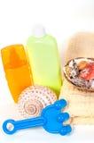 Bottle of shampoo and towel seashells Stock Image