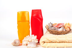 Bottle of shampoo and towel seashells Royalty Free Stock Images