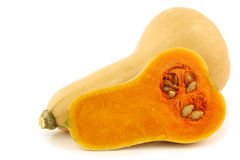 Bottle shaped butternut pumpkin and a cut one Royalty Free Stock Photo