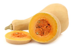Bottle shaped butternut pumpkin and a cut one Royalty Free Stock Images