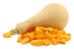 Bottle shaped butternut pumpkin and a cut one Royalty Free Stock Photography