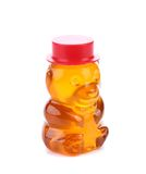 Bottle shaped like a bear and filled with honey Stock Photo