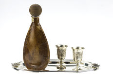 Bottle and silver goblets Stock Photography