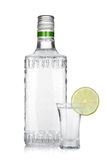 Bottle of silver tequila and shot with lime slice Royalty Free Stock Photo