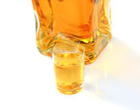 Bottle and small glass Royalty Free Stock Images