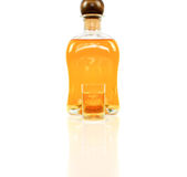 Bottle and small glass Royalty Free Stock Image