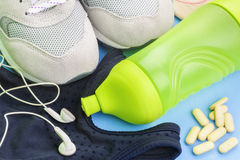 Bottle,sneakers,top,headphones,vitamins running concept Royalty Free Stock Photo