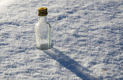 Bottle in snow Stock Photos