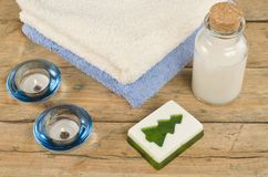 Bottle, soap, candles and towels Stock Images