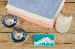 Bottle, soap, candles and towels Royalty Free Stock Photo