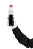 Bottle of soy sauce in the hands Royalty Free Stock Images