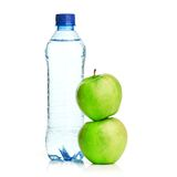 Bottle of sparkling water and green apple Stock Images