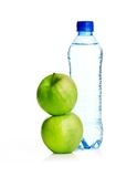 Bottle of sparkling water and green apple Royalty Free Stock Photo