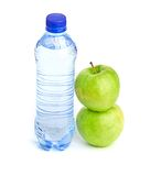 Bottle of sparkling water and green apple Stock Photos