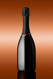 Bottle of sparkling wine on background bronzed Stock Image