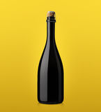 Bottle of sparkling wine with cork on a colored background Royalty Free Stock Photos
