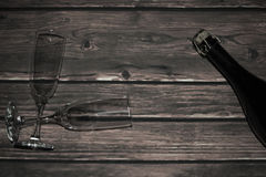 Bottle of sparkling wine and glasses on wooden boards Royalty Free Stock Image