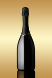 Bottle of sparkling wine on gold background Stock Photos