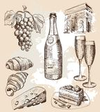 Bottle of sparkling wine and snacks Royalty Free Stock Photo