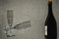 Bottle of sparkling wine and two glasses Stock Photos