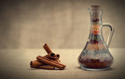Bottle of spices and cinnamon Stock Photo