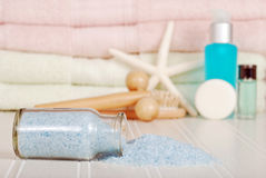 Bottle of spilled bath salts Royalty Free Stock Image