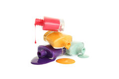Bottle of spilled nail polish isolated on white. Royalty Free Stock Images