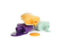 Bottle of spilled nail polish isolated on white. Royalty Free Stock Photography