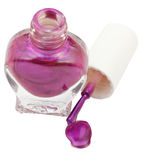 Bottle and spilled violet nail polish isolated Stock Images