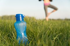 Bottle of sports water. bottle stands on the grass. sporty lifestyle. weight loss stock images