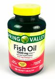 Bottle of Spring Valley Fish Oil Supplement on White Backdrop. A bottle of Spring Valley Fish Oil Supplement on White Backdrop Royalty Free Stock Photos