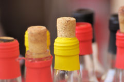 Bottle with stopper. Red and yellow bottles closed crusts Stock Photography
