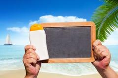 Bottle Suncreen and blank slate blackboard Royalty Free Stock Images