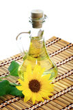 Bottle of sunflower oil. With flower on a white background Stock Image