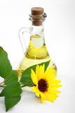 Bottle of sunflower oil. With flower on a white background Royalty Free Stock Images