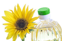 Bottle of sunflower oil with flower isolated on white Stock Images