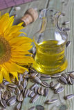 Bottle with sunflower oil. Sunflower seeds and sunflower Royalty Free Stock Photography