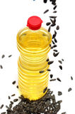 Bottle with sunflower-seed oil. And sunflower seeds on a white background royalty free stock photography