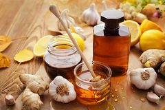 Herbal syrup. Bottle of syrup, honey and herbs Stock Image