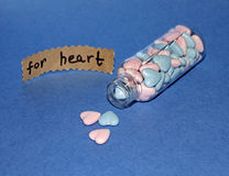 Bottle with tablets for heart disease Stock Images