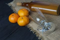 Homemade tangerine tincture on wooden table stock image