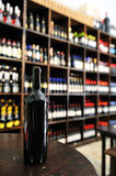 Bottle in tavern. Red wine bottle in tavern Royalty Free Stock Photos