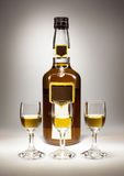 Bottle And Three Glasses of Spirit Drink Royalty Free Stock Image