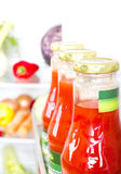 Bottle of tomato juice with fruits and vegetables at background Stock Photos