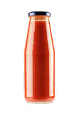 Bottle of tomato ketchup. Glass bottle of red tomato sauce or ketchup, isolated on white background Stock Photography